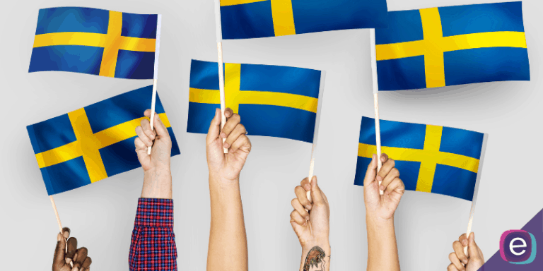 Hands holding up the Swedish flag